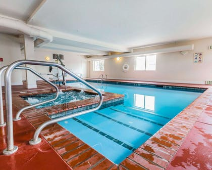 Indoor pool with hot tub | Quality Inn And Suites