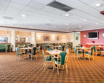 Enjoy breakfast in this seating area   Clarion Inn