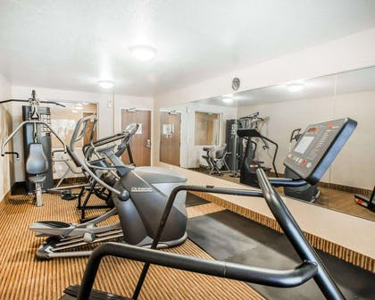 Fitness center with cardio equipment and weights | Quality Inn & Suites Denver International Airport