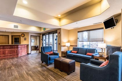Spacious lobby with sitting area | Comfort Inn & Suites Rifle