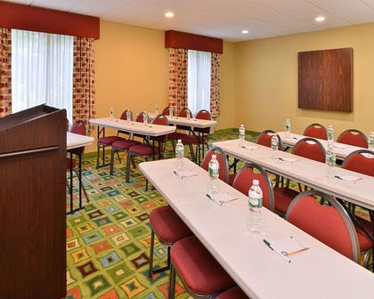 Meeting room with classroom-style setup | Quality Suites
