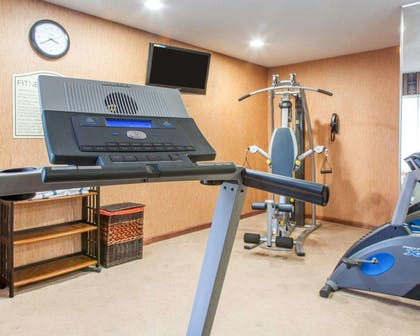 Exercise room with television | Quality Inn & Suites