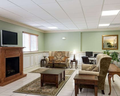 Relax by the fireplace in the lobby | Quality Inn & Suites Rehoboth Beach - Dewey