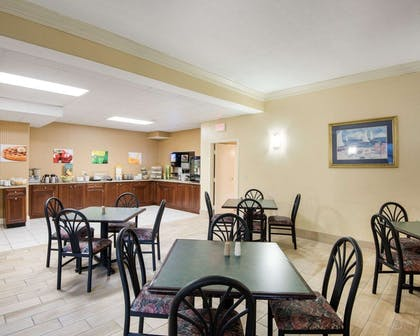 Enjoy breakfast in this seating area | Quality Inn & Suites Rehoboth Beach - Dewey