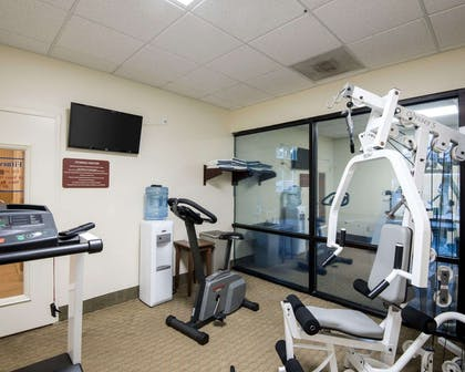 Exercise room with cardio equipment and weights | Quality Inn & Suites Rehoboth Beach - Dewey