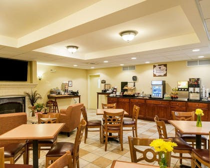 Enjoy breakfast in this seating area | MainStay Suites Dover