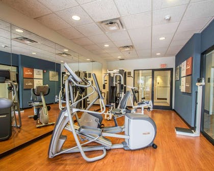 Exercise room with cardio equipment and weights | Comfort Suites Miami - Kendall