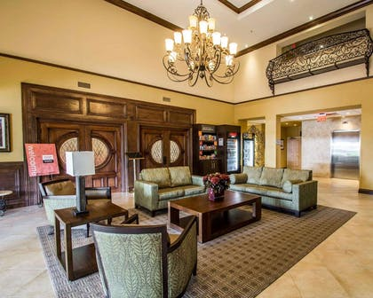Spacious lobby with sitting area | Comfort Suites Miami - Kendall