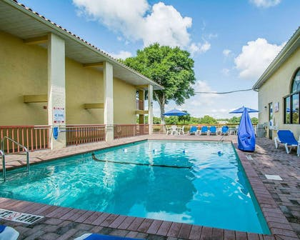 Outdoor pool | Quality Inn & Suites Mt Dora North