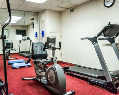 Fitness center with cardio equipment   Quality Suites Fort Myers - I-75