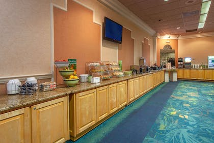 Breakfast area | Quality Inn & Suites Port Canaveral Area