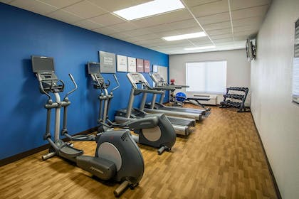 Exercise room with cardio equipment and weights | Comfort Suites Near Universal Orlando Resort