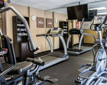 Exercise room with cardio equipment and weights | Comfort Suites Clearwater - Dunedin