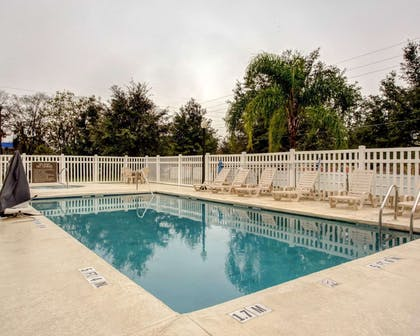 Outdoor pool with sundeck | Comfort Suites Ocala North