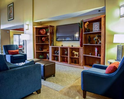 Spacious lobby with sitting area | Comfort Suites Ocala North