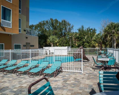 Outdoor pool with sundeck   Comfort Suites At Fairgrounds-Casino