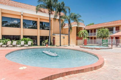 Relax by the pool | Quality Inn & Suites Conference Center