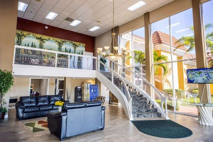 Spacious lobby with sitting area | Quality Inn & Suites Conference Center