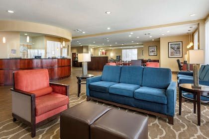 Spacious lobby with sitting area   Comfort Suites Orlando Airport