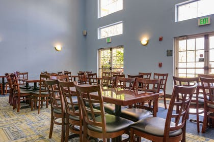 Enjoy breakfast in this seating area | Quality Suites Lake Buena Vista