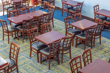 Enjoy breakfast in this seating area   Quality Suites Lake Buena Vista