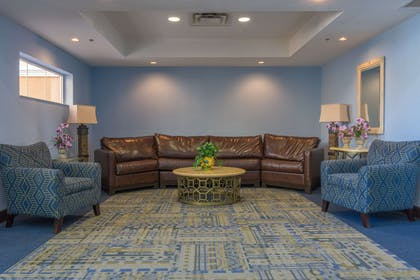 Spacious lobby with sitting area | Quality Suites Lake Buena Vista