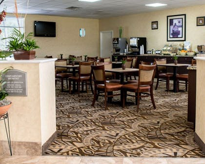 Enjoy breakfast in this seating area | Quality Inn & Suites Near Fairgrounds Ybor City