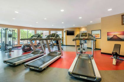 Exercise room with cardio equipment and weights | Cambria Hotel Ft Lauderdale, Airport South & Cruise Port