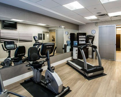 Fitness center with cardio equipment and weights | Comfort Suites Miami Airport North