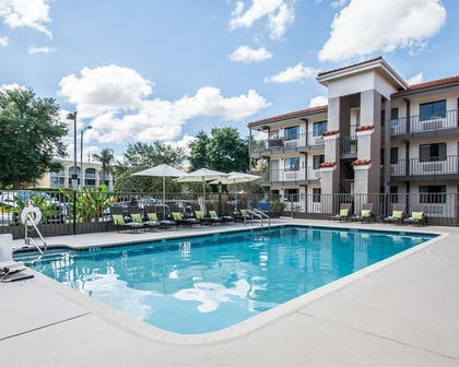 Outdoor pool | Quality Inn & Suites By the Parks