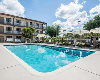 Outdoor pool with sundeck | Quality Inn & Suites By the Parks