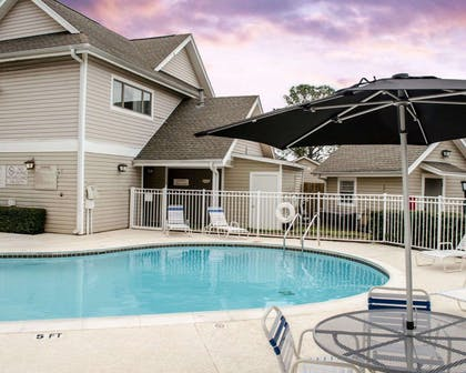 Outdoor pool | Mainstay Suites