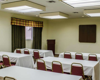 Meeting room with classroom-style setup | Mainstay Suites