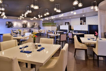 On-site restaurant | Clarion Inn & Suites Across From Universal Orlando Resort