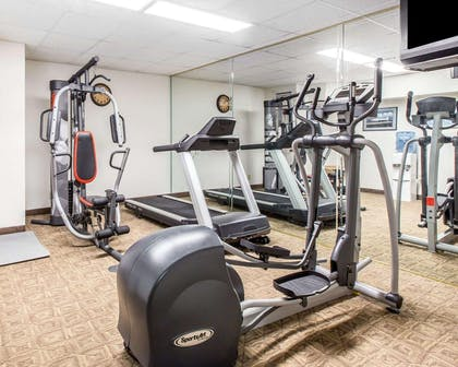 Fitness center with cardio equipment and weights | Comfort Inn & Suites near Robins Air Force Base