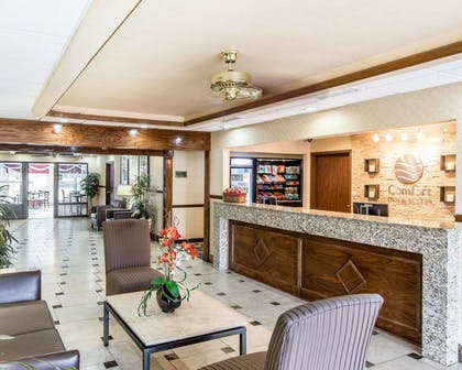 Spacious lobby with sitting area | Comfort Inn & Suites near Robins Air Force Base