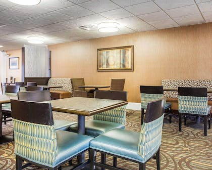 Enjoy breakfast in this seating area | Comfort Inn & Suites at Stone Mountain