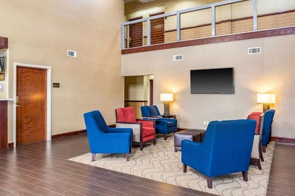 Spacious lobby with sitting area   Comfort Suites near Robins Air Force Base