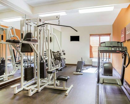 Fitness center with cardio equipment and weights   Comfort Suites Northlake