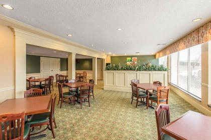 Breakfast seating | Quality Inn & Suites Conference Center