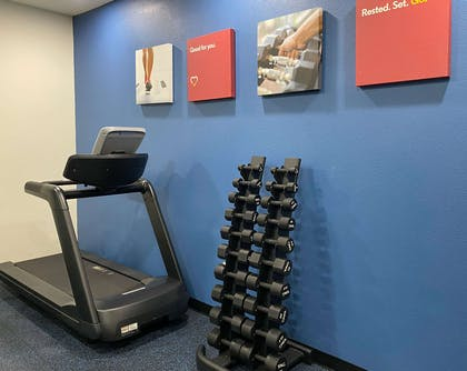 Exercise room with cardio equipment and weights   Comfort Suites Kings Bay Naval Base Area