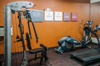 Fitness center with cardio equipment and weights | Comfort Suites Milledgeville