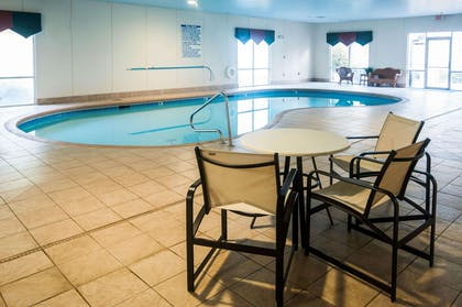 Indoor pool with table and chairs | Comfort Suites Milledgeville