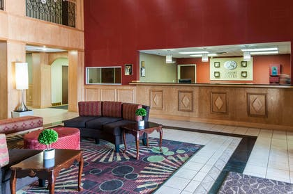 Spacious lobby with sitting area | Comfort Suites Milledgeville