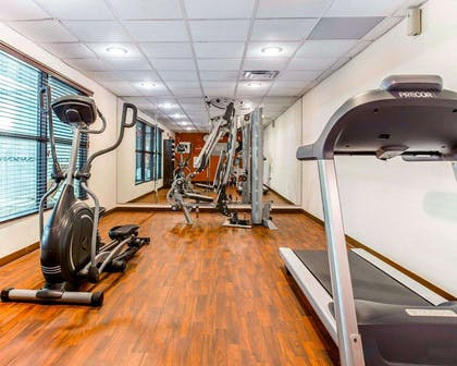 Fitness center with cardio equipment and weights | Comfort Suites At Kennesaw State University