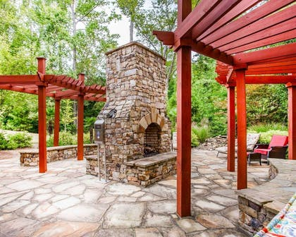 relax by the fireplace on the hotel patio | Comfort Suites At Kennesaw State University