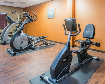 Fitness center with cardio equipment and weights | Comfort Suites Atlanta Airport