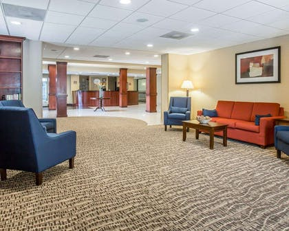 Spacious lobby with sitting area | Comfort Suites Atlanta Airport