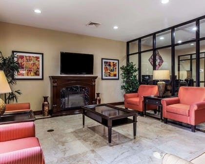 Relax by the fireplace in the lobby | Comfort Suites Waycross