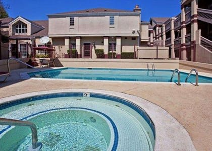 Outdoor pool with hot tub | Quality Suites Buckhead Village